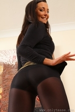 Stunning brunette in gold shiny miniskirt with opaque pantyhose - 09