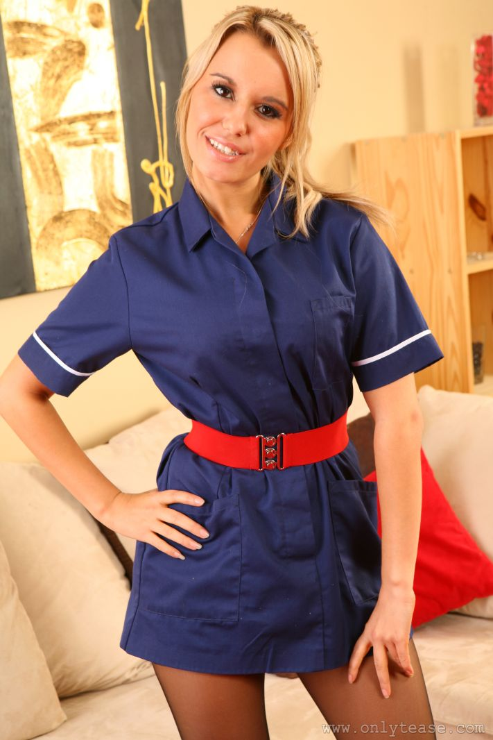 This naughty nurse bares all as she strips out of her tight blue minidress and heels