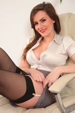 Sexy specced brunette in black stockings - 10