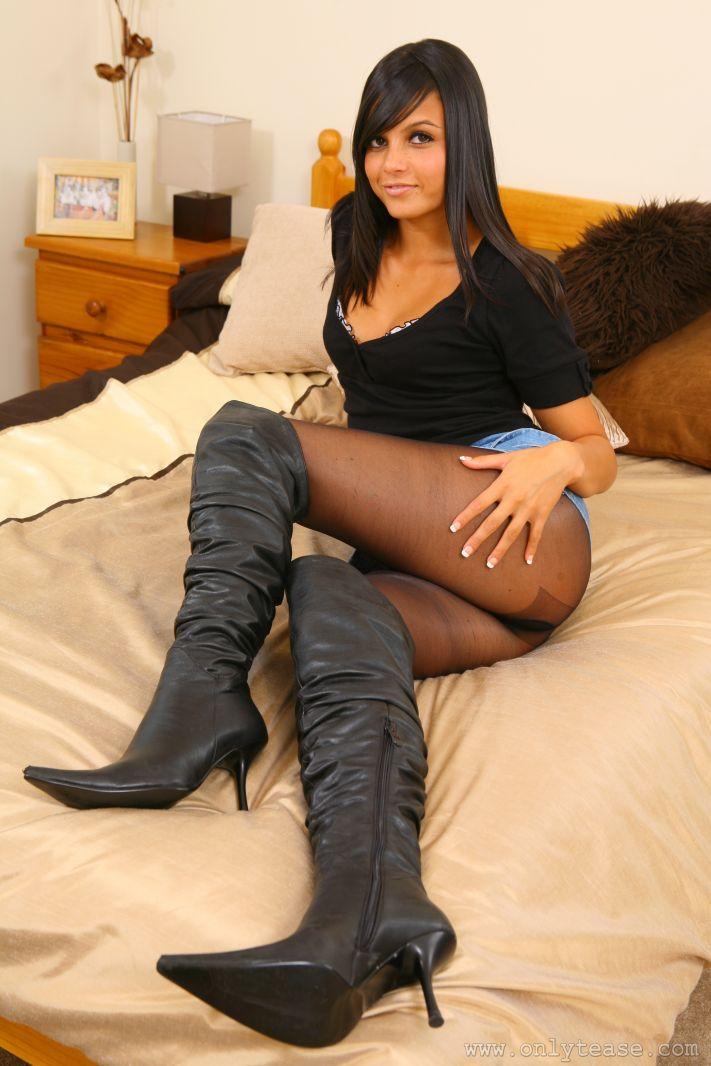 Bebe looks delightful in denim miniskirt tight blouse black pantyhose and high heels