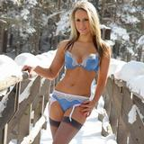 """hottie Candice strips in the snow only wearing stockings"""