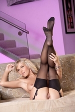 Cikita looks horny wearing black lingerie and stockings teasing in a couch - 12