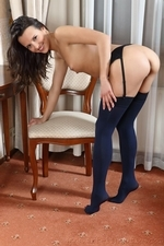 Gorgeous brunette in navy opaque stockings and a purple chemise - 12