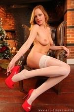 Sexy redhead around the Christmas tree - 16