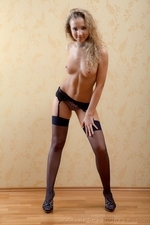 Curvacious blonde in purple lingerie and black stockings - 06