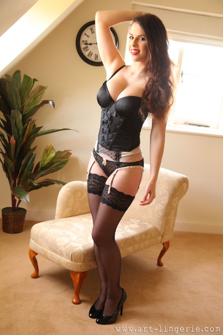 Busty Jo in black stockings and suspenders