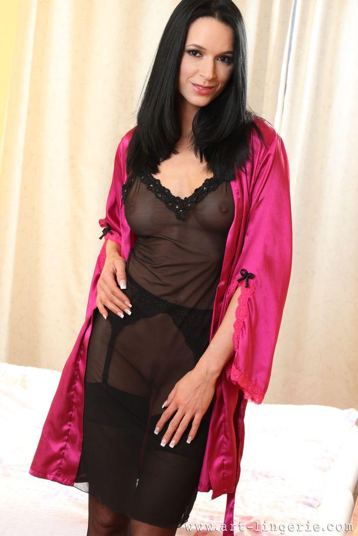 Skinny brunette in black stockings and lingerie