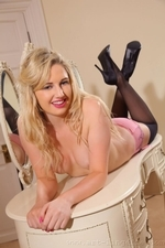 Milly shows off her incredible figure as she poses in just her stockings and heels - 08