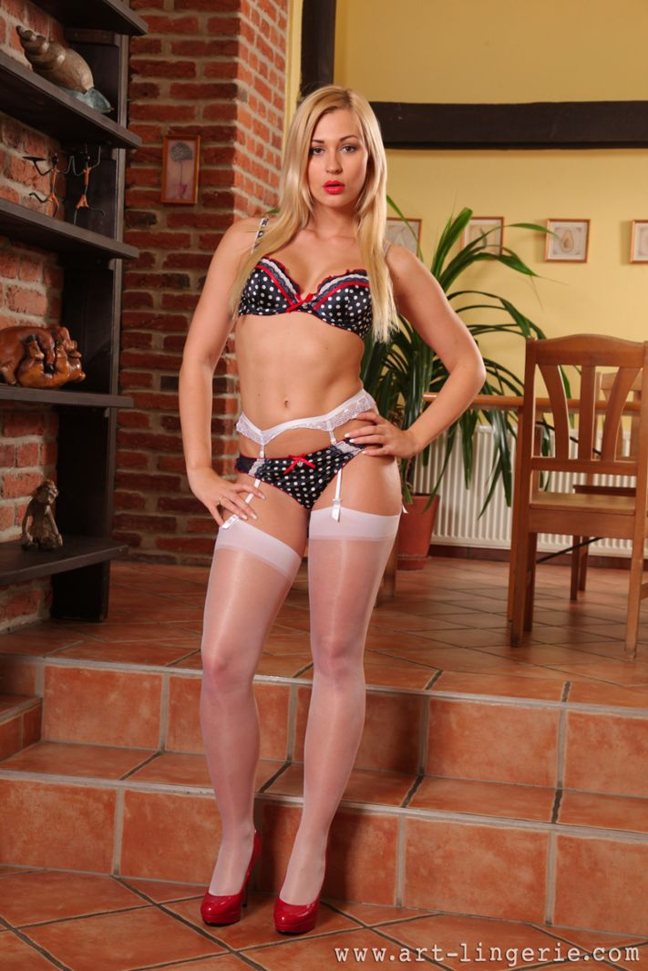 Sultry blonde in white stockings