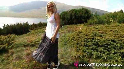"""""""Tammy enjoys sunny day dressed in long skirt and white top."""""""