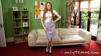 """Outstanding redhead slowly removes sexy office outfit revealing cream tights and lace lingerie."""