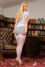 Bubbly Hollie In The Library Flashing Her Layered Nylons - Picture 2