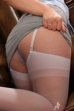 Bubbly Hollie In The Library Flashing Her Layered Nylons - Picture 5
