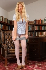 Bubbly Hollie In The Library Flashing Her Layered Nylons - Picture 6