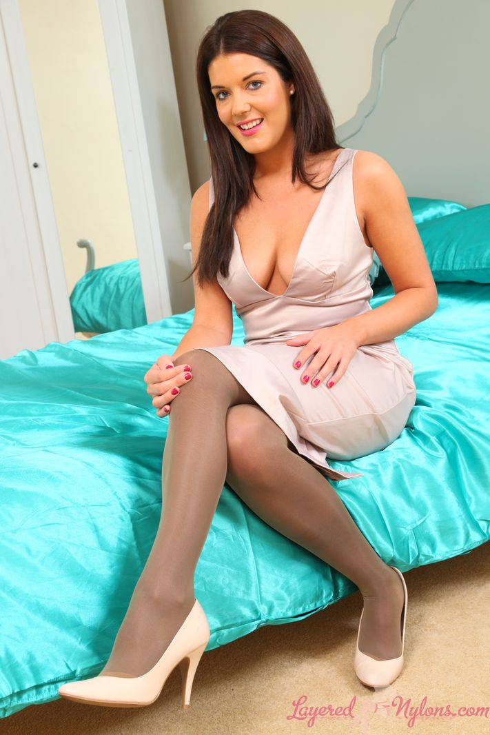 Busty brunette Kelly in satin lingerie with nylons