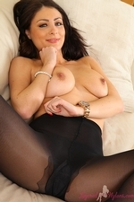 Sexy Brunette Tammy Taylor In Miniskirt And Layered Legwear - Picture 15