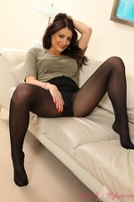 Brunette in miniskirt and layered legwear - 11