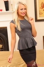 Smiling blonde in her layered nylons - 02