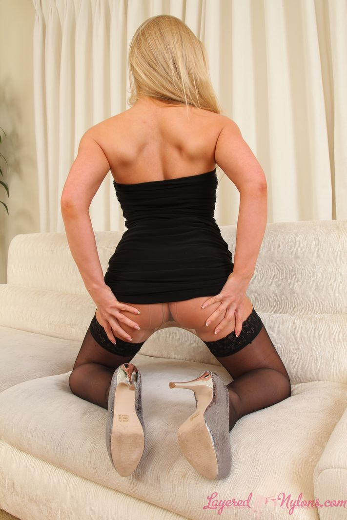 Mega busty blonde in layered nylons