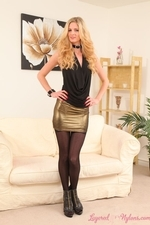 Leggy blonde in black layered stockings and tights - 01