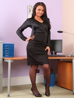 Saucy Sarah teases her way out of her tight black office clothes and reveals sexy black satin lingerie