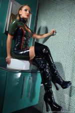 Kinky blonde in a tight latex dress and thigh high boots - 03