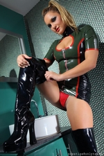 Kinky blonde in a tight latex dress and thigh high boots - 05