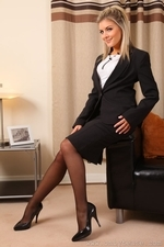 Blondge Naomi shows her naughty side in mini skirt and black stockings - 02