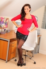 Sexy brunette Daisy in black miniskirt and suspenders - 01