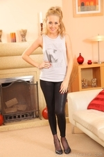 Cute Lucy in the lounge in black leggings and heels - 01