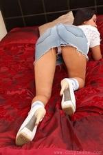 Jasmin in the bedroom in white top and denim skirt - 02