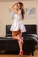 Michelle teases her way from little white dress in the bedroom - 02