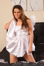 Michelle teases her way from little white dress in the bedroom - 07