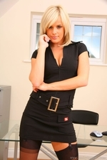 Delightful secretary slips out of the tight minidress and shows off sexy underwear - 02