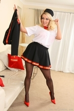 Busty blonde slowly removes the uniform revealing sexy red lingerie - 08