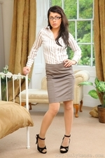 Sexy secretary in specs and stockings - 01