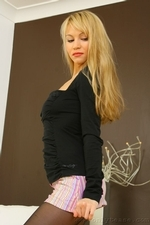Beautiful blonde Elen in a tight black top and sexy microskirt - 02