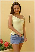 Carla Enjoys The Sun In A Tight Yellow Top - Picture 12
