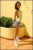 Carla Enjoys The Sun In A Tight Yellow Top - Picture 5