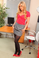 Saucy Blonde Secretary Samantha K Reveals Raunchy Red Lingerie As She Teases Her Way Out Of Her Office Clothes - Picture 1