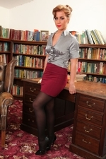 Busty Georgina Getting Naked In The Study - Picture 1