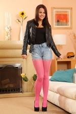 Robyn H Looks Stunning In Bright Pink Pantyhose And Denim Shorts - Picture 1