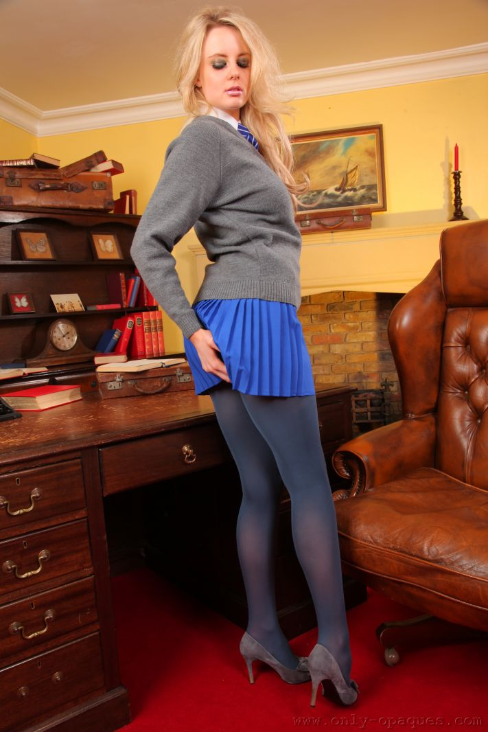 Amber Leigh strips out of her short blue miniskirt and tight grey sweater