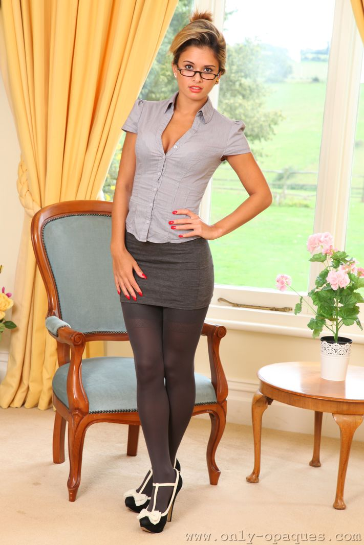 Sexy speced secretary in opaque stockings
