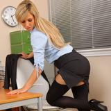 """""""Sophia K entertains her colleagues by stripping out of her tight black skirt suit and showing off her sexy curves in just a paid or black stockings."""""""