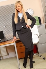 Sophia K entertains her colleagues by stripping out of her tight black skirt suit and showing off her sexy curves in just a paid or black stockings - 01