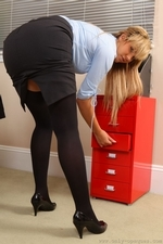 Sophia K entertains her colleagues by stripping out of her tight black skirt suit and showing off her sexy curves in just a paid or black stockings | 19 October 2015