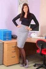 Beautiful secretary posing in the office - 01