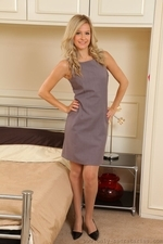 Elle is wearing a shift dress with tan stockings - 01