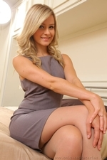 Elle is wearing a shift dress with tan stockings - 03
